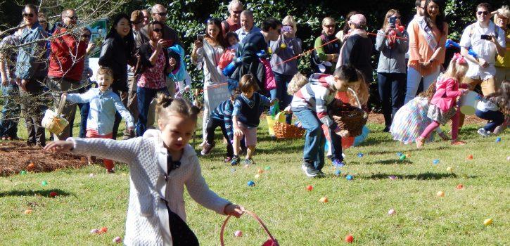 little girl in an Easter egg hunt